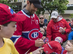 Canadiens captain Max Pacioretty signs autographs during annual Hockey de Rue charity event at the YMJA on Westbury St. in Montreal on May 27, 2018.