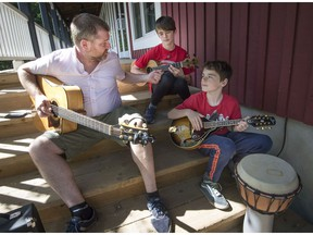 Tim Walsh (left) jams with brothers Kyle and Nilan Vergnano-Mcrae (right) at the Stephen F. Shaar Community Centre in Hudson on Saturday.