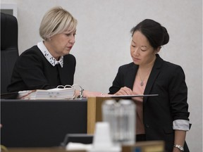 Lead coroner Andree Kronstrom, left, prepares to open an inquest in to the June 2016 death of Mario-Nelson Boucher at a Montreal men's shelter.
