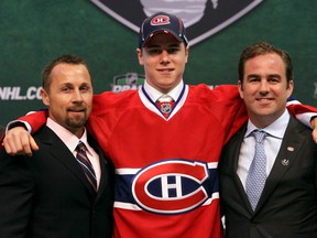 """""""We want players with character and we'll be looking at speed because it's a fast game,"""" Trevor Timmins, Canadiens director of player personnel, says of the NHL Entry Draft. Timmins, left, is seen here with the team's seventh overall pick, Nathan Beaulieu, and Canadiens owner Geoff Molson at the 2011 draft in St Paul, Minn."""