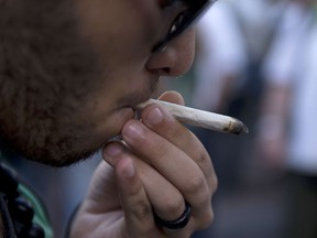 A man smokes a joint — in public.