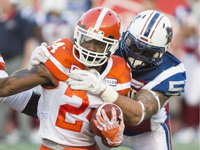 Former Montreal Alouettes defensive end Gabriel Knapton tackles B.C. Lions running back Jeremiah Johnson during first half CFL football action in Montreal, Thursday, July 6, 2017.