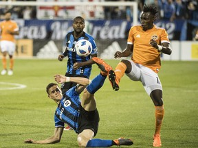 Houston Dynamo's Alberth Elis, right, challenges Montreal Impact's Jukka Raitala during second half MLS soccer action in Montreal on June 2, 2018. Raitala will miss Saturday's game in Dallas because he has been called up by the Finnish national team for a friendly against Belarus.