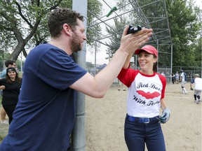 Joey Berger high-fives Marisa Berry Mendez after she scored a run during exhibition softball game between local players and Expos Nation at Jeanne Mance Park in Montreal Saturday July 14, 2018.  The event was held in response to the Plateau Mont-Royal's decision to close the north softball field in the same park.  (John Mahoney / MONTREAL GAZETTE) ORG XMIT: 61056 - 2172