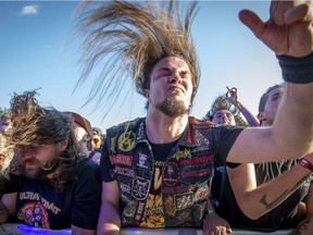Fans of Trivium bounce to the music at the Heavy Montreal Festival on Sunday, July 29, 2018.