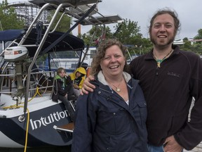 Carole Plouffe, her husband Benoit Plamondon, and their two young kids, 12-year-old Ludvik, in yellow, and eight-year-old Kilian, are living on a sailboat in the La Ronde marina in Montreal before leaving for their year-long adventure in September.