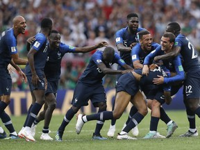 French players celebrate at the end of the final match between France and Croatia at the 2018 soccer World Cup in the Luzhniki Stadium in Moscow, Russia, Sunday, July 15, 2018. France won 4-2. (AP Photo/Petr David Josek)