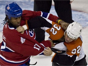 The Canadiens' Georges Laraque and the Philadelphia Flyers' Riley Cote fight during NHL game at the Bell Centre in Montreal on Dec. 7, 2009.
