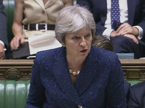 In this image from TV, Britain's Prime Minister Theresa May gives statement in the parliament Monday July 9, 2018. British Foreign Secretary Boris Johnson resigned Monday, adding to divisions over Brexit that threaten to tear apart Prime Minister Theresa May's government.