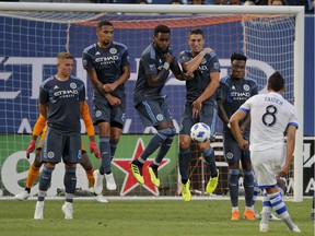 New York City FC players block a free kick by Montreal Impact midfielder Saphir Taider (8) during the first half of an MLS soccer match Wednesday, July 11, 2018, in New York.