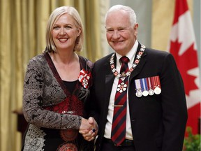 Governor General David Johnston invests Carmen Campagne as a Member of the Order of Canada during a ceremony at Rideau Hall Friday, Sept. 12, 2014 in Ottawa. Canadian singer-songwriter Campagne died of cancer at the age of 58, on July 4.