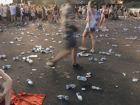 """This was Juliana Yang's third year at Osheaga, """"and I have never stepped on water bottles every two steps the way I did this year,"""" she says. Evenko responds that last weekend's heat wave necessitated a mass distribution of bottled water at the festival, despite the promoter's green initiatives."""