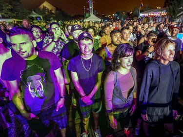 Music fans listen to Fischerspooner on the main stage during Pride festivities in Montreal on Friday, August 17, 2018.