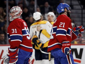 Canadiens goaltender Carey Price and defenceman David Schlemko look away as the Nashville Predators celebrate a goal last season. It was a familiar sight during a brutal year.