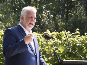 Philippe Couillard's Liberal Party holds 68 of the 125-seat National Assembly going into the election set for Oct. 1