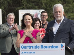 Quebec Liberal Leader Philippe Couillard announces that Jean-Lesage candidate Gertrude Bourdon, centre, would become health minister in a Liberal government, in Quebec City on Friday, August 24, 2018. Former Quebec Health Minister Gaetan Barrette, left, applauds as Bourdon puts her hands to her chest. Physician Brian Gore says whoever next serves as health minister needs to re-establish a healthier and more collaborative climate in our health-care institutions.