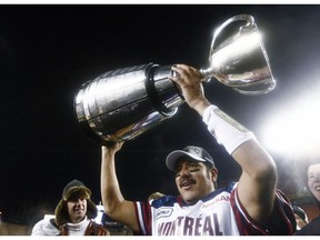 Montreal Alouettes quarterback Anthony Calvillo hoists the Grey Cup after their win over the Saskatchewan Roughriders in the CFL Grey Cup game Sunday November 28, 2010 in Edmonton. Calvillo has announced his retirement from the CFL team.