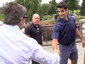 Canadiens general manager Marc Bergevin, left, shakes hands with team captain Max Pacioretty at Jonathan Drouin Golf Tournament on Sept. 6, 2018 in Terrebonne while Pacioretty's agent, Allan Walsh, looks on.