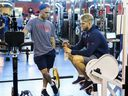 Former first-round NHL Draft picks Max Domi, left, and Joel Armia talk while waiting their turns during fitness testing on the first day of Canadiens' training camp at the Bell Sports Complex in Brossard on Sept. 13, 2018.