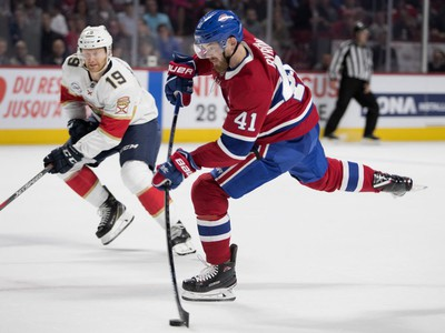 Left wing Paul Byron takes a slap shot on Florida Panthers goaltender Roberto Luongo as Florida Panthers defenseman Mike Matheson looks on during NHL pre-season action in Montreal on Wednesday, Sept. 19, 2018.
