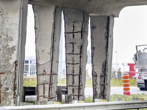 Exposed rebar in the support structures of the Chenin des Chenaux overpass in Vaudreuil-Dorion as of last September. The Highway 40 overpass has since been closed for structural issues.