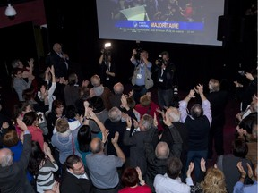 Liberal supporters react as they announce a Quebec Liberal majority government on television during the party celebrations on April 7, 2014, in St-Félicien.