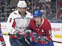 Canadiens' Artturi Lehkonen, right, is checked by Capitals' Alex Ovechkin, during pre-season action in QUebec City.