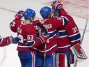 Canadiens' Brendan Gallagher and Matthew Peca congratulate goalkeeper Charlie Lindgren after winning 5-2 against the Capitals Thursday night in Quebec City.