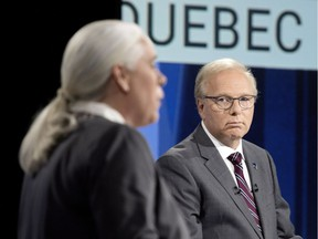 Parti Quebecois Leader Jean-Francois Lisee listens as Quebec Solidaire co-spokesperson Manon Masse speaks during the English language leaders' debate in Montreal Sept. 17, 2018.