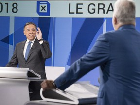 """In the French debate Thursday, Liberal Leader Philippe Couillard, right, came across as calm and competent, but the sometimes fiery CAQ Leader, François Legault, was the face of """"change."""""""