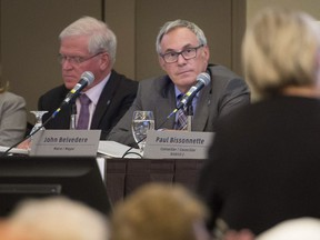 Pointe-Claire Mayor John Belvedere (centre) announced on Tuesday night that a reworking of the special planning program for the village and its code would involve public consultations and input from the local heritage society.