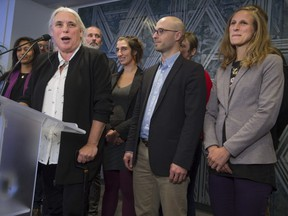 Québec solidaire's newly elected MNAs stand with Manon Massé after holding their first caucus meeting on Friday.