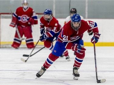 Montreal Canadiennes' Hilary Knight takes the puck up the middle of the ice during a 3-1 loss to the Calgary Inferno at Place Bell in Laval on Sunday October 14, 2018.