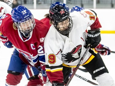 Montreal Canadiennes captain Marie-Philip Poulin and Calgary Inferno's Brianne Jenner at a face-off during a 3-1 loss to Calgary at Place Bell in Laval on Sunday October 14, 2018.
