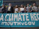 Lawyers and youth plaintiffs line up behind a banner on July 18 2018 after a hearing before Federal District Court Judge Ann Aiken between lawyers for the Trump administration and the so-called Climate Kids in Eugene, Ore. The young activists are suing the U.S. government in a high-profile climate change lawsuit.