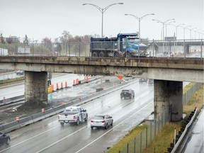 A dump truck crosses the old Doney Spur rail overpass, which will be torn down this weekend, forcing the closure of a stretch Highway 40 — including the service road — in both directions.