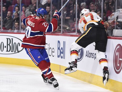 Nicolas Deslauriers pushes Mark Jankowski of the Calgary Flames into the boards during at the Bell Centre on Tuesday, Oct. 23, 2018.