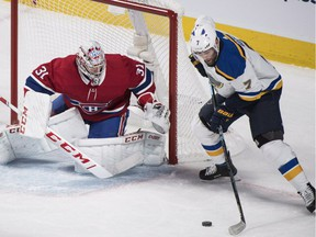St. Louis Blues' Pat Maroon moves in on Montreal Canadiens goaltender Carey Price during first period in Montreal on Oct. 17, 2018.