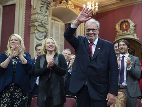 Quebec Liberal Opposition Leader Pierre Arcand waves to the applauding crowd before being sworn in as member of the National Assembly Monday, October 15, 2018 at the legislature in Quebec City. MNAs, from the left, Paule Robitaille, Lise Theriault and Christine Saint-Pierre applaud.