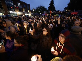 People hold candles as they gather for a vigil in the aftermath of a deadly shooting at the Tree of Life Congregation, in the Squirrel Hill neighborhood of Pittsburgh, Saturday, Oct. 27, 2018.