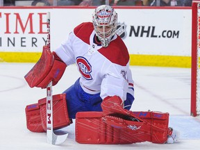 Canadiens' Carey Price  makes a glove save against the Flames in Calgary on Thursday, Nov. 15, 2018.