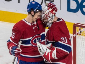 Canadiens centre Jesperi Kotkaniemi and goalie Carey Price share a moment after Montreal's last-minute victory over the Stanley Cup-champion Capitals Thursday night at the Bell Centre.