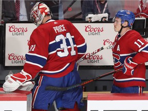 Canadiens' Brendan Gallagher gives goalie Carey Price a supportive pat after the goalie allowed six goals in a loss to the Sabres Thursday night at the Bell Centre.