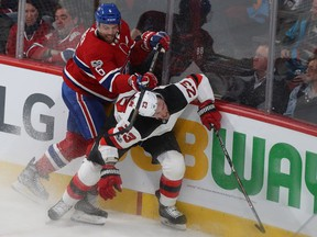 Montreal Canadiens' Shea Weber lifts his stick on New Jersey Devils' Stefan Noesen in Montreal on Dec. 14, 2017.