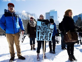 University student Camille Caron, centre, joins the crowd of Franco-Ontarians outside of Queen's Park in Toronto calling for a new francophone university on Thursday, February 18, 2016.