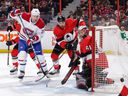 Senators goalie Craig Anderson follows the puck as teammate Cody Ceci defends against Nicolas Deslauriers of the Montreal Canadiens in the first period at Canadian Tire Centre on Dec. 6, 2018 in Ottawa.