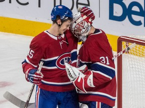 Canadiens centre Jesperi Kotkaniemi  congratulates goalie Carey Price after beating the Washington Capitals 6-4 during NHL game at the Bell Centre in Montreal on Nov. 1, 2018.