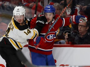 Canadiens forward Charles Hudon battles with the Boston Bruins' Chris Wagner during game at the Bell Centre in Montreal on Nov. 24, 2018.