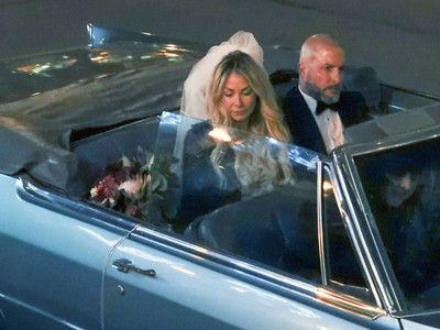 Annie Arbic arrives with Hells Angel member Martin Robert for their wedding in downtown Montreal on Saturday, DEc. 1, 2018.