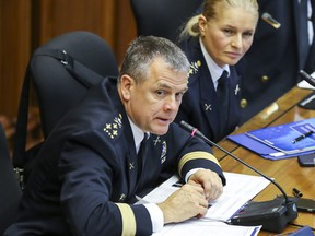 Police chief Sylvain Caron answers questions during hearing by Montreal's public-security commission on the police department's plan to tackle social and racial profiling, at City Hall in Montreal Tuesday December 11, 2018. Listening is deputy chief Simonetta Barth.